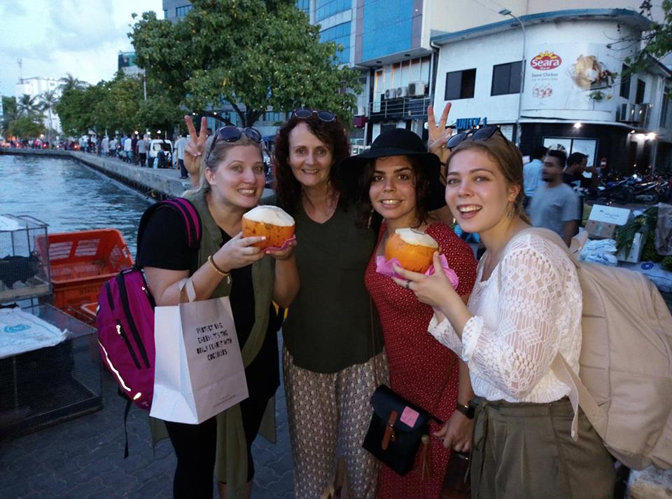 Leeann and her friends showing nostraw needed to enjoy a kurumba on yesterday's Male walking tour